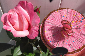 Fair Trade hand crafted basket made from seed beads. Round shape with lid. These baskets take 1 full day to create.  Rich Pink