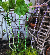 Load image into Gallery viewer, Handmade long length multicolor necklace made from magazines with accent seed beads in between. Each bead is hand rolled. green and white green and purple and white pictured