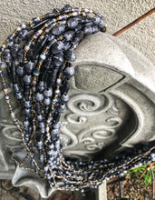 Load image into Gallery viewer, Hand crafted faded/weathered black paper bead and black and grey with gold accent bead necklace style made from magazines. Each bead individually rolled by hand.  Stylish and Fashionable for casual or dressy. Fair trade.