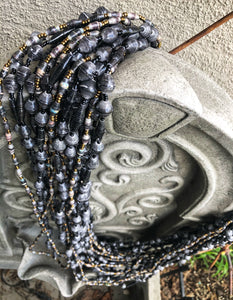 Hand crafted faded/weathered black paper bead and black and grey with gold accent bead necklace style made from magazines. Each bead individually rolled by hand.  Stylish and Fashionable for casual or dressy. Fair trade.