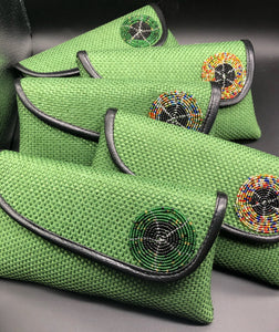 staggered green clutches, round bead on flap, black piping around edge of flap
