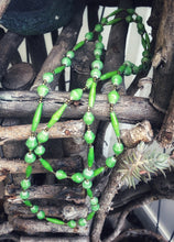 Load image into Gallery viewer, Handmade long length multicolor necklace made from magazines with accent seed beads in between. Each bead is hand rolled. Weathered green pictured
