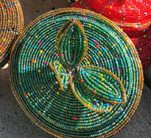 Load image into Gallery viewer, Fair Trade hand crafted basket made from seed beads. Round shape with lid. These baskets take 1 full day to create.  Sea foam green with gold accent around the edge of lid.