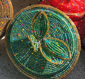 Fair Trade hand crafted basket made from seed beads. Round shape with lid. These baskets take 1 full day to create.  Sea foam green with gold accent around the edge of lid.