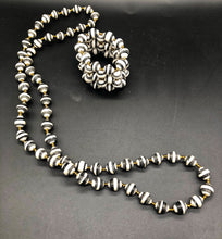 "Load image into Gallery viewer, Hand crafted black and white medium length necklace and stretch bracelet set.  Approximately 18"" Long. Made from magazines. Each bead individually rolled by hand.  Stylish and Fashionable for casual or dressy. Fair trade."