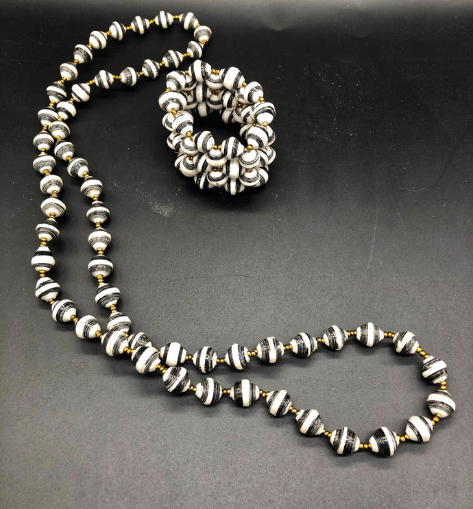 Hand crafted black and white medium length necklace and stretch bracelet set.  Approximately 18
