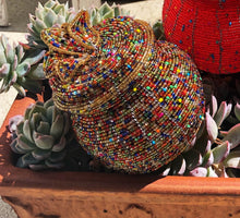 Load image into Gallery viewer, Fair Trade hand crafted basket made from seed beads in the shape of a jar with lid. Regular size baskets take at least a day to create.  Large baskets take 1 1/2 - 2 days to create. Gold multi color
