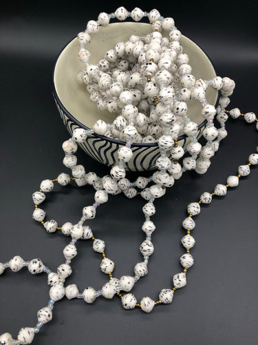 Hand crafted white with black accent paper bead necklace made from magazines. Each bead individually rolled by hand.  Stylish and Fashionable for casual or dressy. Fair trade.  Approximately 18