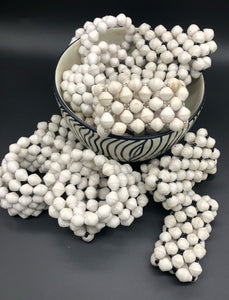 Hand crafted solid white wrap bracelet and solid white stretch bracelets with black, silver or gold bead embellishment Each bead individually rolled by hand from magazines.  Stylish and fashionable for casual or dressy. Fair trade.