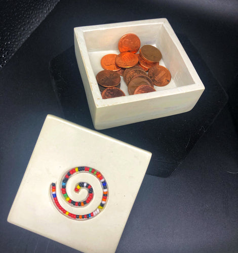 Square Shaped Soapstone box open with bead embellished lid displayed in front of box.  Box contains pennies
