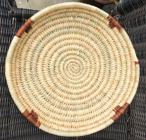"Handwoven fair trade sturdy African tray basket made from papyrus reed grown in Kenya. Natural color 15"" round basket"