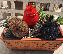 Load image into Gallery viewer, Fair Trade hand crafted basket made from seed beads in the shape of a jar with lid. Regular size baskets take at least a day to create.  Large baskets take 1 1/2 - 2 days to create. Red, Black and Gold Multi colors