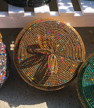 Load image into Gallery viewer, Fair Trade hand crafted basket made from seed beads. Round shape with lid. These baskets take 1 full day to create. Gold with multi color bead accent.