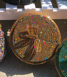 Fair Trade hand crafted basket made from seed beads. Round shape with lid. These baskets take 1 full day to create. Gold with multi color bead accent.