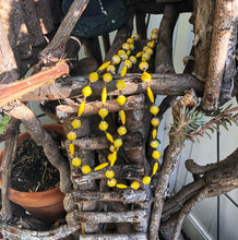 "Load image into Gallery viewer, Long handmade paper bead necklace and stretch bracelet set weathered yellow color. Necklace is approximately 30"" long and usually worn doubled. Bracelet is a stretch bracelet. Handcrafted from magazines. Fair trade. Color Yellow stretch bracelet and necklace pictured"