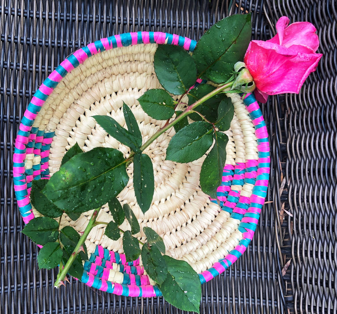 Hand woven fair trade African baskets from Kenyan grown papyrus reed natural color with pink and teal embellishment woven into the design