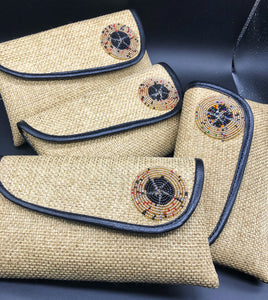 4 beige clutches leaning on one another in a row, round beads on flap, black piping lines flap edge