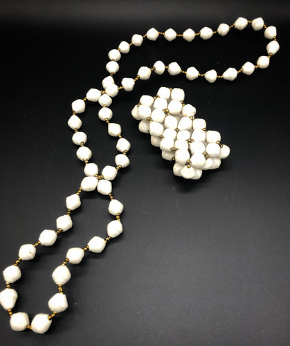 "Hand crafted medium length white paper bead necklace approximate length 18"" and stretch bracelet set with gold bead embellishment made from magazines. Each bead individually rolled by hand.  Stylish and Fashionable for casual or dressy. Fair trade."