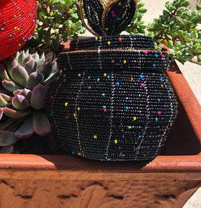 Fair Trade hand crafted basket made from seed beads in the shape of a jar with lid. Regular size baskets take at least a day to create.  Large baskets take 1 1/2 - 2 days to create. Black w/multi color embellishment