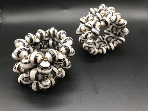 Hand crafted stretch bracelet made from magazines and each bead individually rolled by hand.  Special black and white paper bead stretch bracelet - Stylish and Fashionable for casual or dressy. Fair trade.