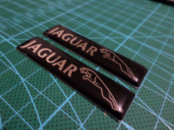 2 Pics Jaguar Badge