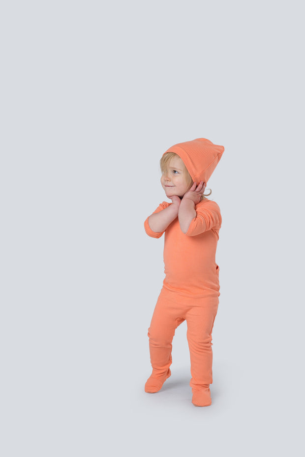 Snug fitting  ribbed footie and beanie in coral 1