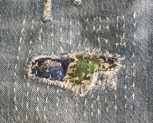 My Year of Not Buying New Clothes - Darned Jeans