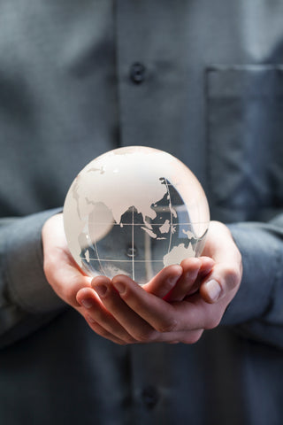 Man holding glass globe in his hands
