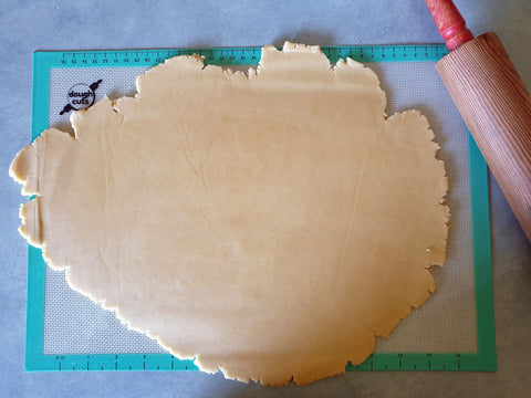Rolled out cookie dough ready for cutting into cookie cake shape