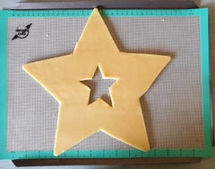 Star cutout cookie on doughcuts silicone baking mat