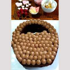 Image of flower basket cake all piped and ready for it's toppers