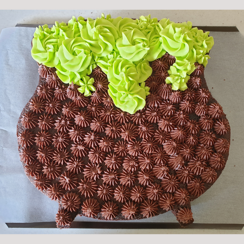 Image of cauldron cake with buttercream bubbles coming out of the top.