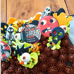Close up of cauldron shaped cake toppers
