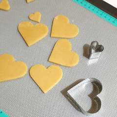 Image of small heart cookies made as cookie cake toppers