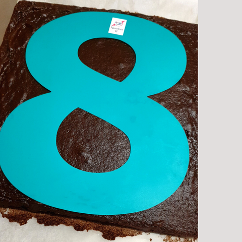 Number 8 Cake Stencil on Chocolate Cake