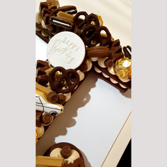 Close up image of letter T cookie cake toppers