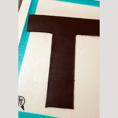 Image of letter T cookie cutout ready for baking