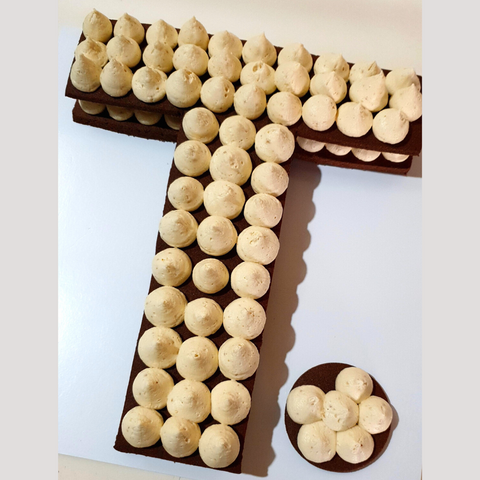 Image of letter T cookie with caramel fudge buttercream piped on top