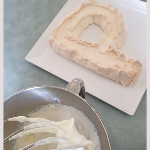 Letter Shaped Pavlova Ready For Decorating