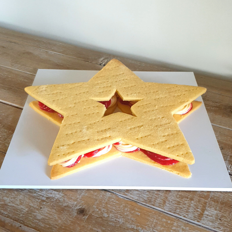 Image of ice cream sandwich large made from shortbread, vanilla ice cream and raspberry sorbet