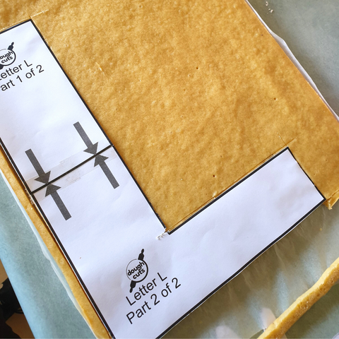 Cutting out a Letter Cake with A Template