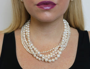 Hazel & Marie: Cultured Pearl necklace, 5 strand in natural on model