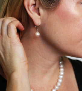 Hazel & Marie: Cultured Pearl earrings on sterling silver on model side