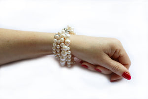 Hazel & Marie: Cultured Pearl bracelet with 5 strand twisted on model