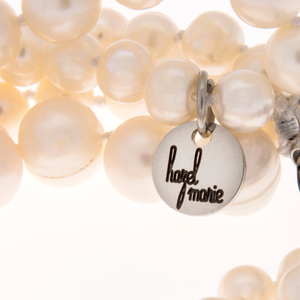 Hazel & Marie: Zoomed in Cultured Pearl necklace tag