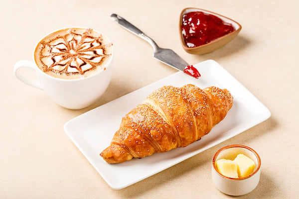 Butter croissant and cappucino