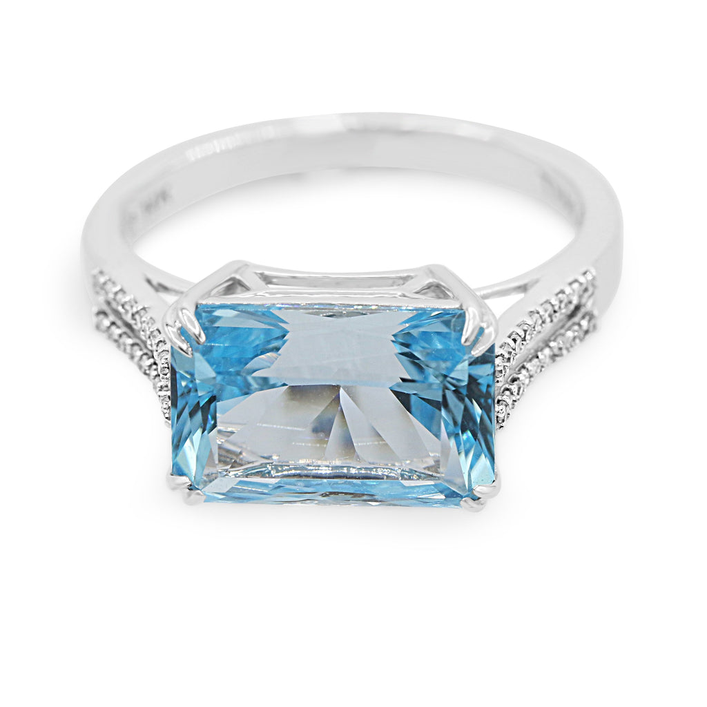 Enchanting 14K White Gold Diamond Blue Topaz Ring (0.10ct Carat Diamond Weight)