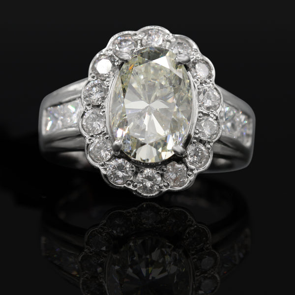 Diamond Oval Halo Ring In Platinum ( 2.80ct Ov dtw / 1.28ct Rnd dtw)
