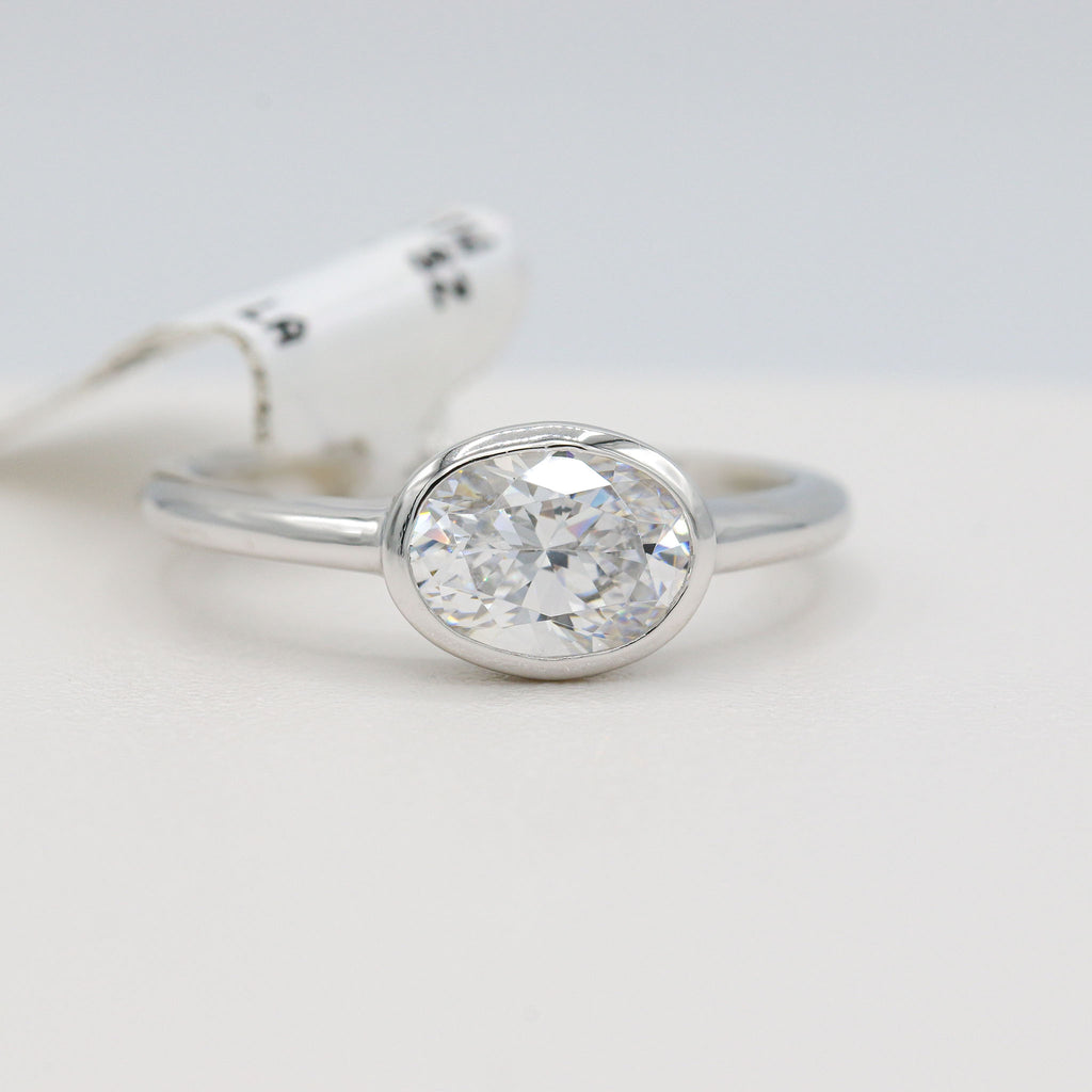 Tantalizing Lafonn Sterling Silver Bonded in Platinum Oval Bezel Ring (1.21ct Simulated Diamonds)
