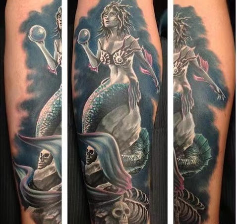 Tattoo myth-snake around the mermaid